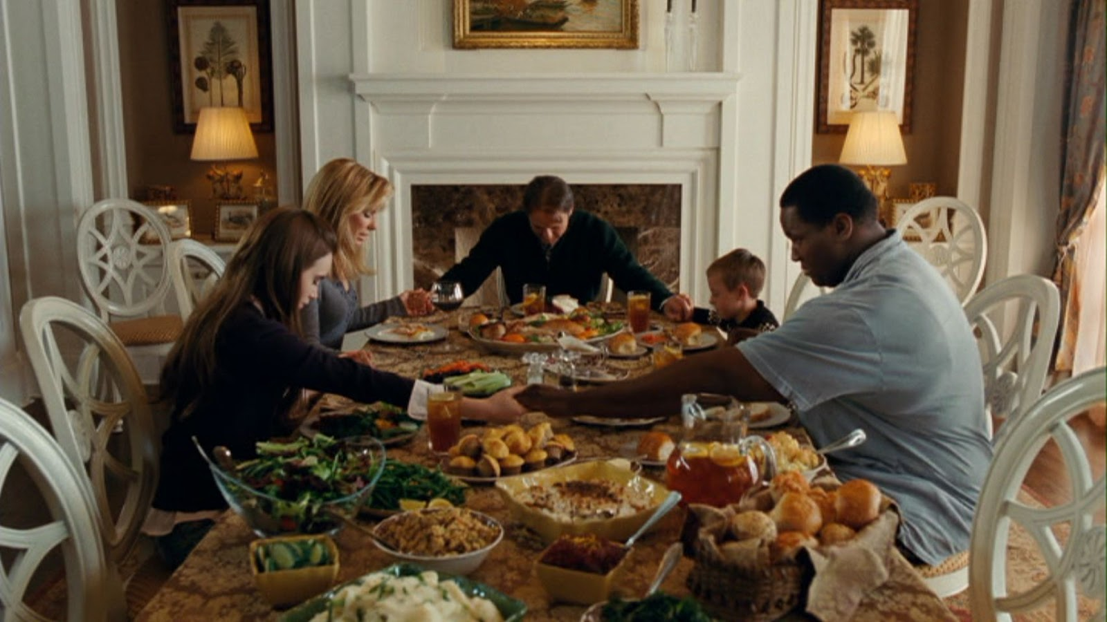 women in sports week the blind side the most insulting movie the tuohy family prays over mounds of food