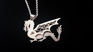 https://www.etsy.com/listing/206034566/sterling-silver-dragon-pendant-necklace