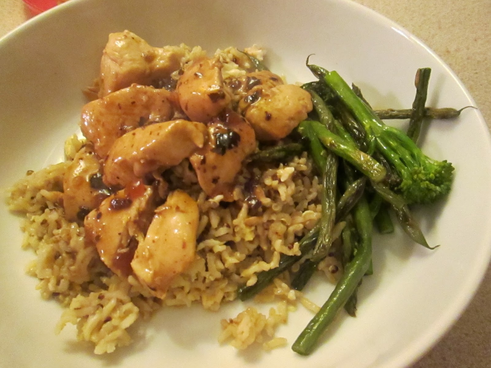 Chicken in black bean sauce with egg-fried brown rice and quinoa