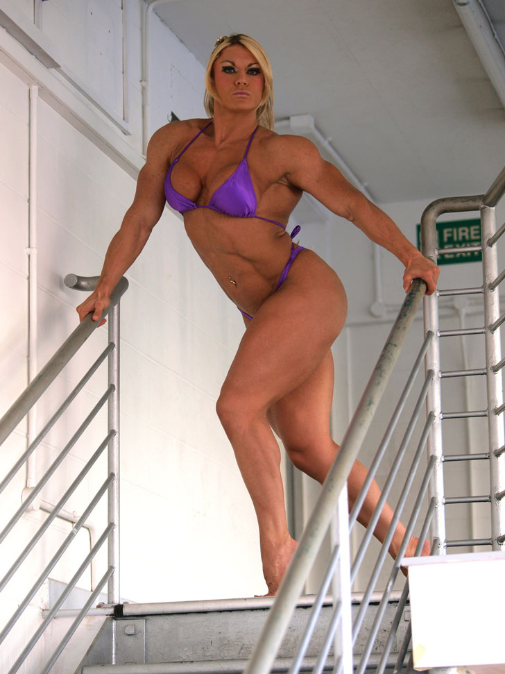 Lisa Cross Models Her Muscular Physique In A Purple Bikini