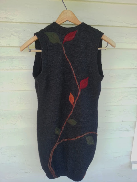 back of the sweater decorated with felted leaves