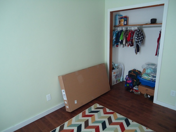 Nursery closet and crib mattress boxed up