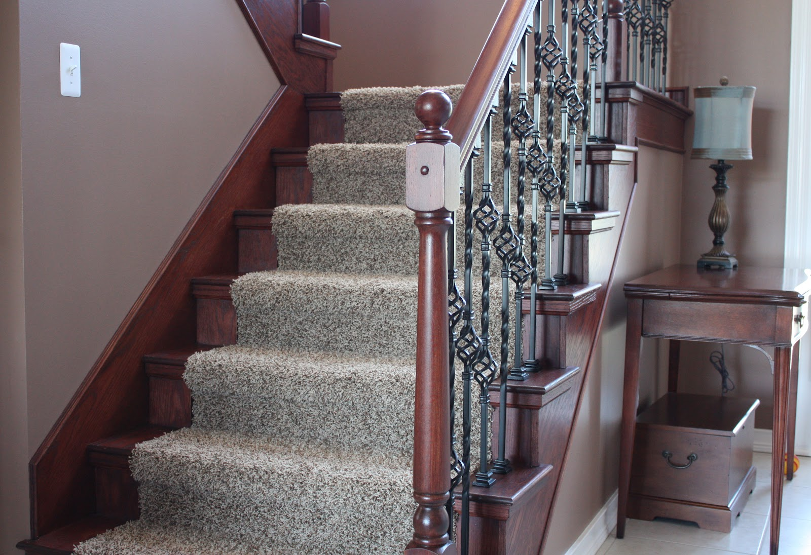 The Staircase And Catwalk Are Vital Organs In This Split Level Home.