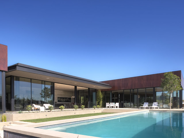 Photo of modern luxury house in Hollywood as seen from the pool area during the day