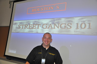 Officer Vento gives a presentation on Houston gangs to teachers.