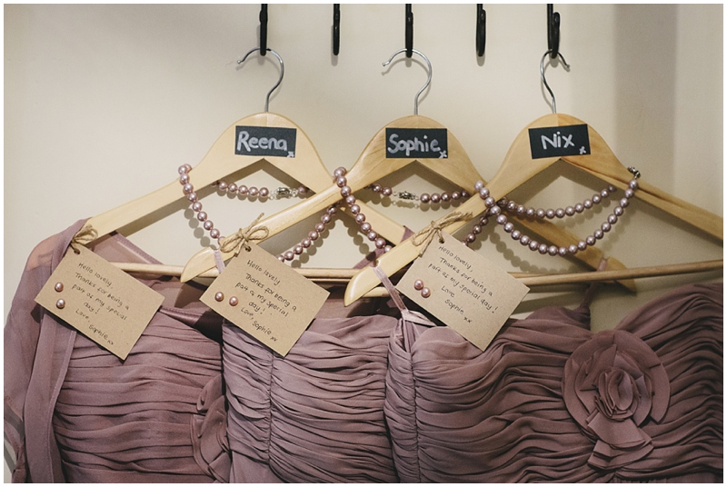 Bridesmaids' dresses on hangers