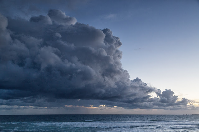 cumulus clouds over ocean
