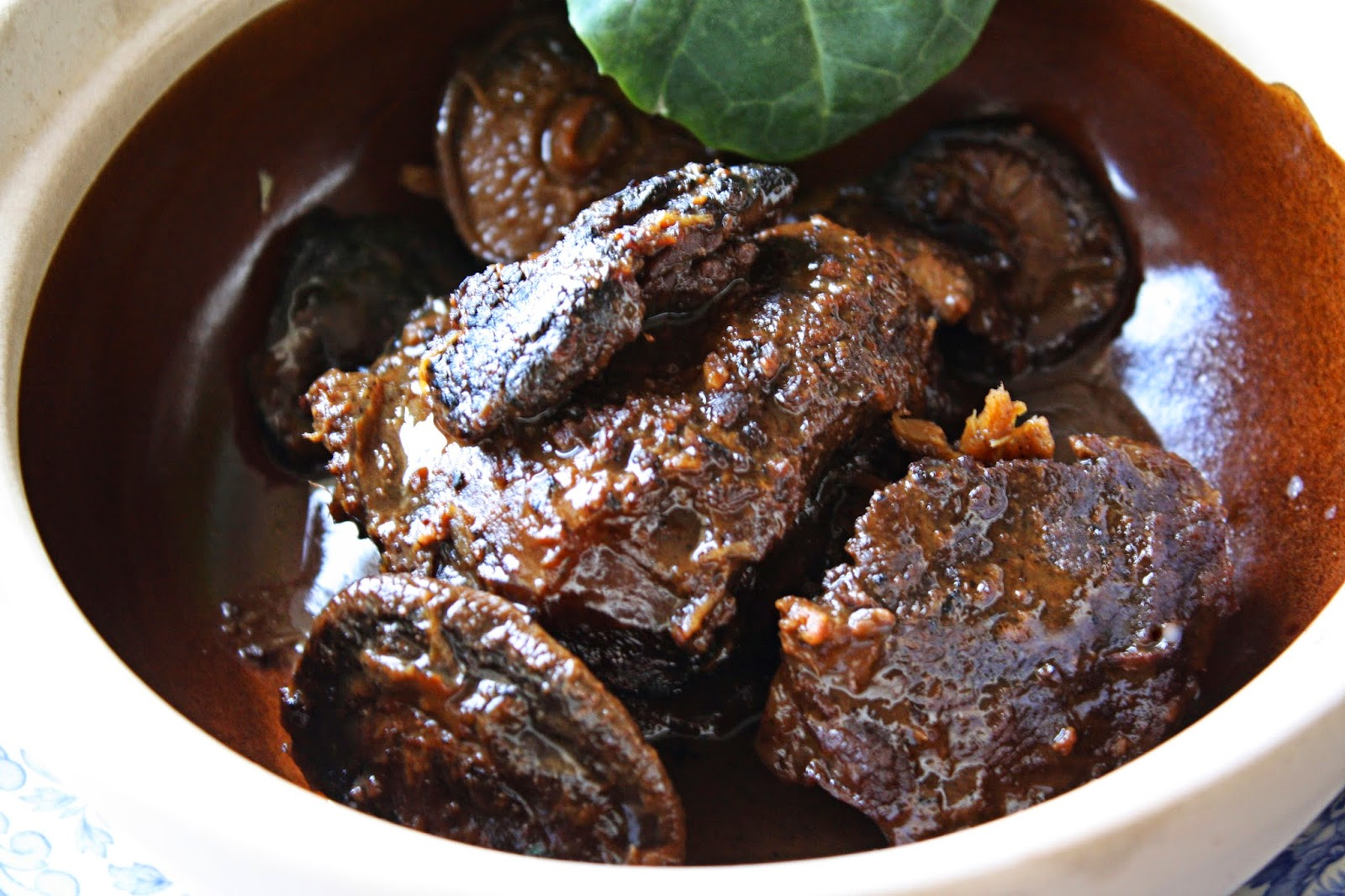 slow cooked ginger and dark soy beef cheeks