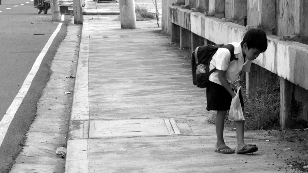 Child searching for stuffs, Street photography