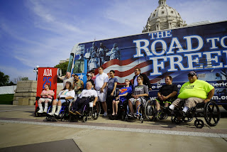 Advocates pose in front of the Road to Freedom bus