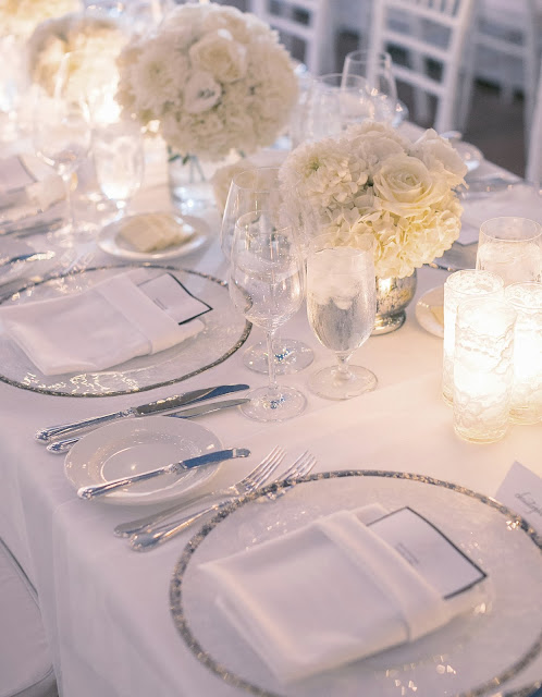 long table centerpiece with white flowers and mercury glass