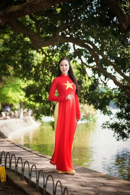 Girl Viet Nam in Ao Dai national flag