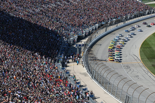 Kevin Harvick, driver of the #4 Jimmy John's / Budweiser Chevrolet, leads the field at the start of the NASCAR Sprint Cup Series myAFibRisk.com 400 at Chicagoland Speedway on September 20, 2015 in Joliet, Illinois. (Sept. 19, 2015 - Source: Matt Sullivan/Getty Images North America)