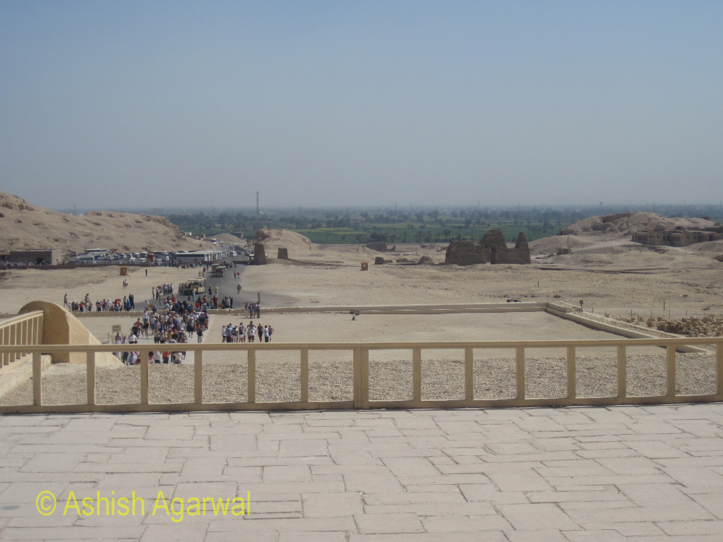 View from a section of the upper level of the Hatshepsut temple of tourists at the lower level