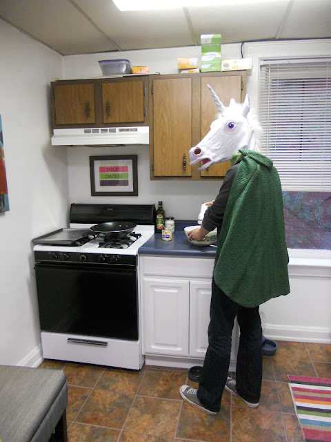 Man in Unicorn Mask bakes cheesecake using mixer
