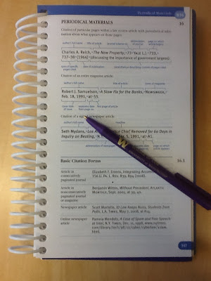 Photo of open Bluebook with pen