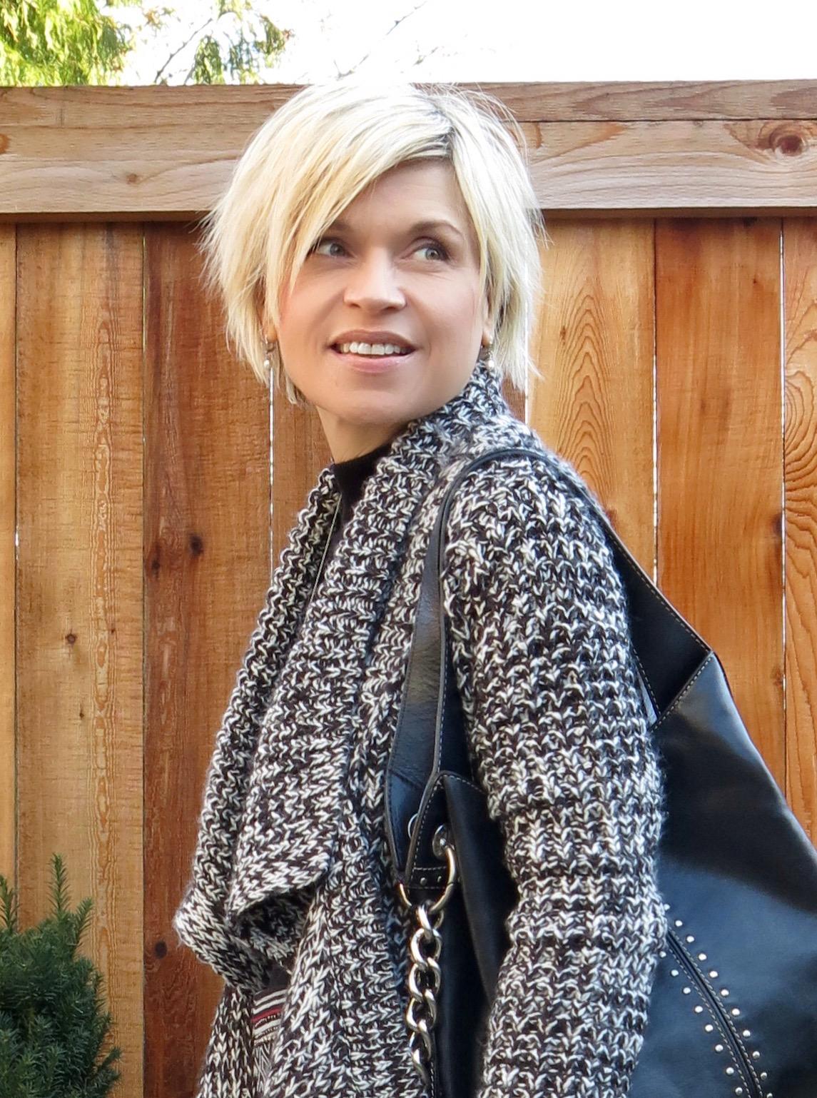long cardigan and studded Michael Kors bag