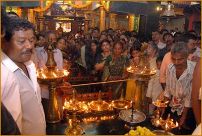 A temple full of offerings for Mahashivaratri is crowded with worshipers