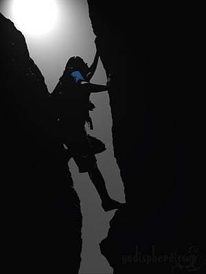 Silhouette of Man rock climbing on mountain ridge