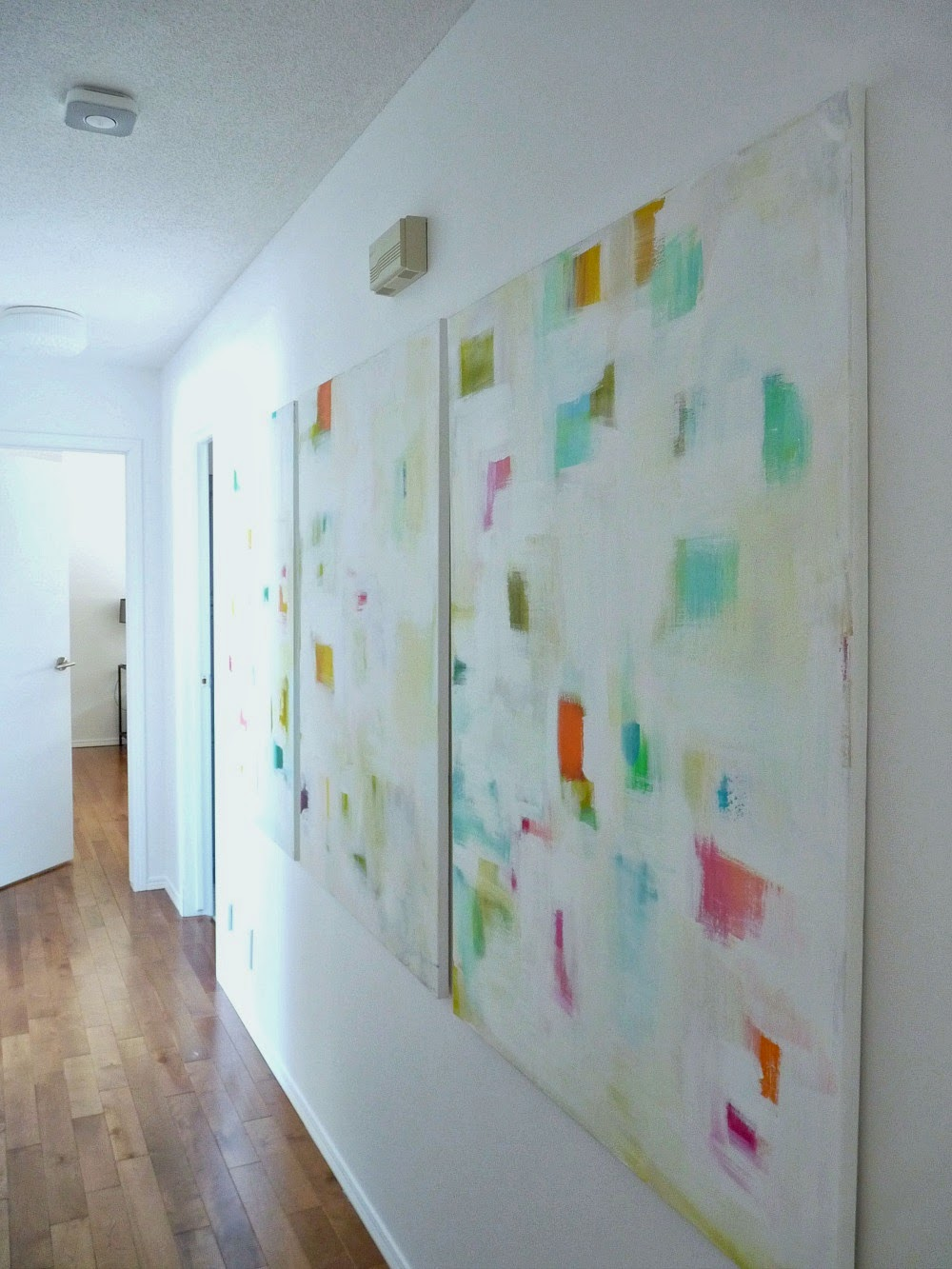 All White Hallway with Colorful Art