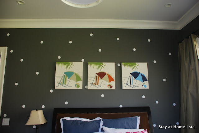 white polka dots on a dark gray wall
