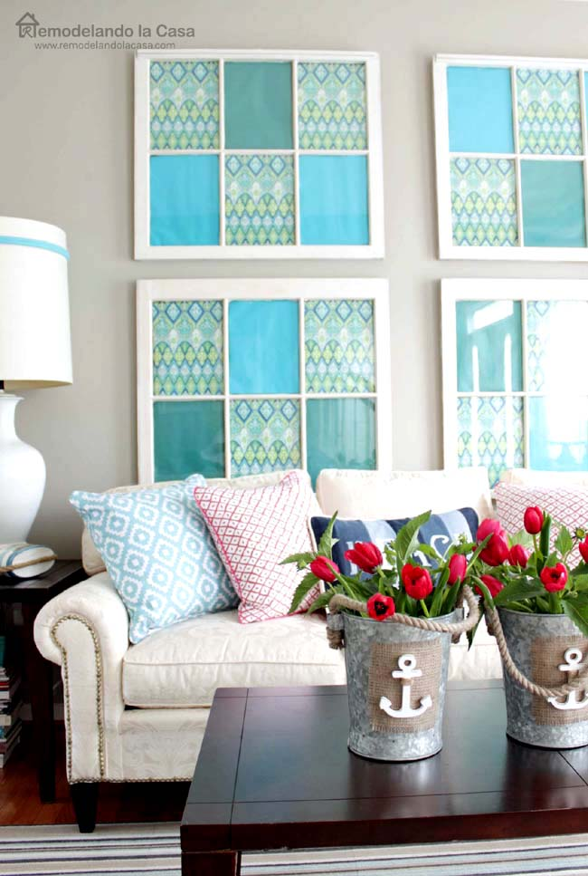 old windows as art, metal buckets with anchors and red tulips, white sofa and blue and hot pink pillows