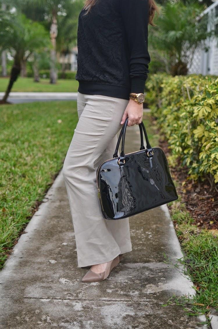 Tan pants - Black sweater - patent bag - Emma & Sophia