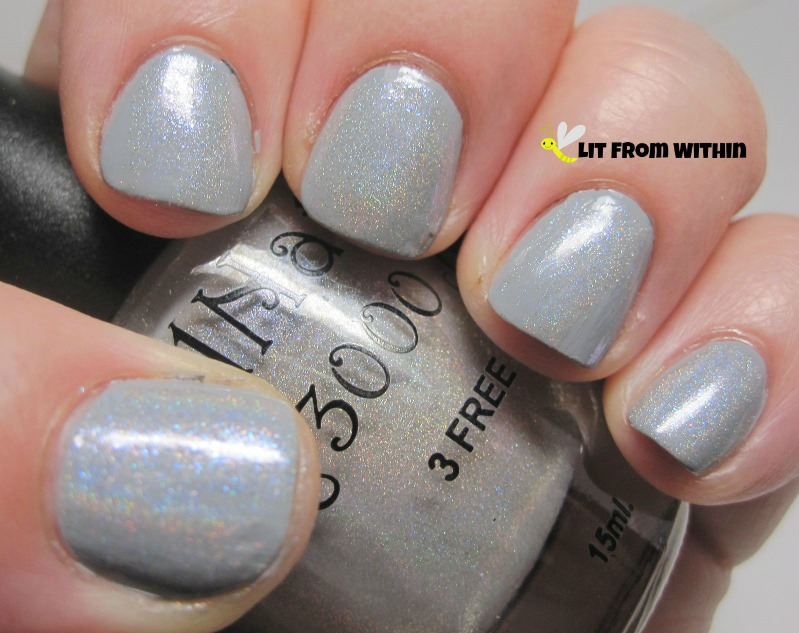 for a little sparkle, I layered NailNation 3000 Dancing In The Sky, a light grey holo