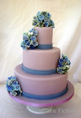 wedding cake with blue and violet hydrangeas
