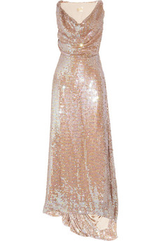 Dripping in glittering sequins, this Basix gown boasts a sheer skirt to reveal a hint of gorgeous gams.