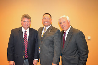 McCormick (center) with Attorneys General Jim Hood of Mississippi (l) and James D.