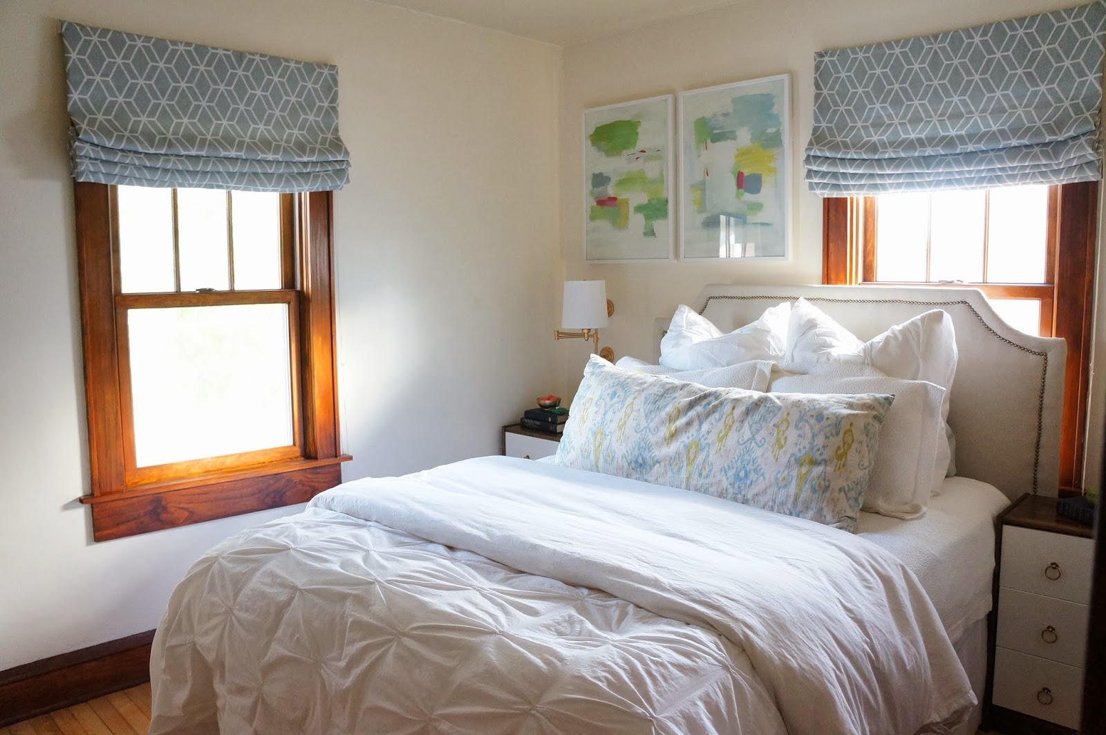 Light and Bright Bedroom Off Centered Window Over Bed