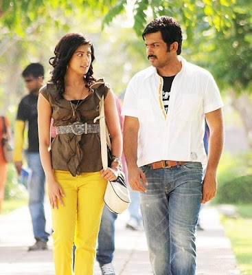 Karthi and Pranitha hot stills in Saguni