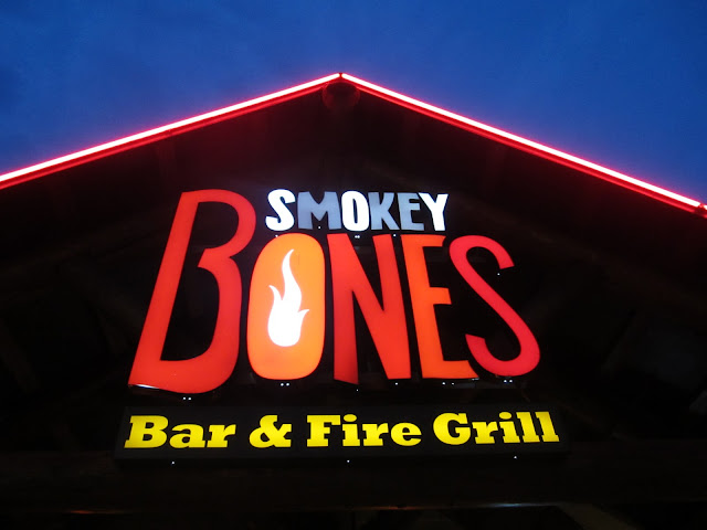 Sign out front of Smokey Bones Bar & Fire Grill in Tyngsboro, MA