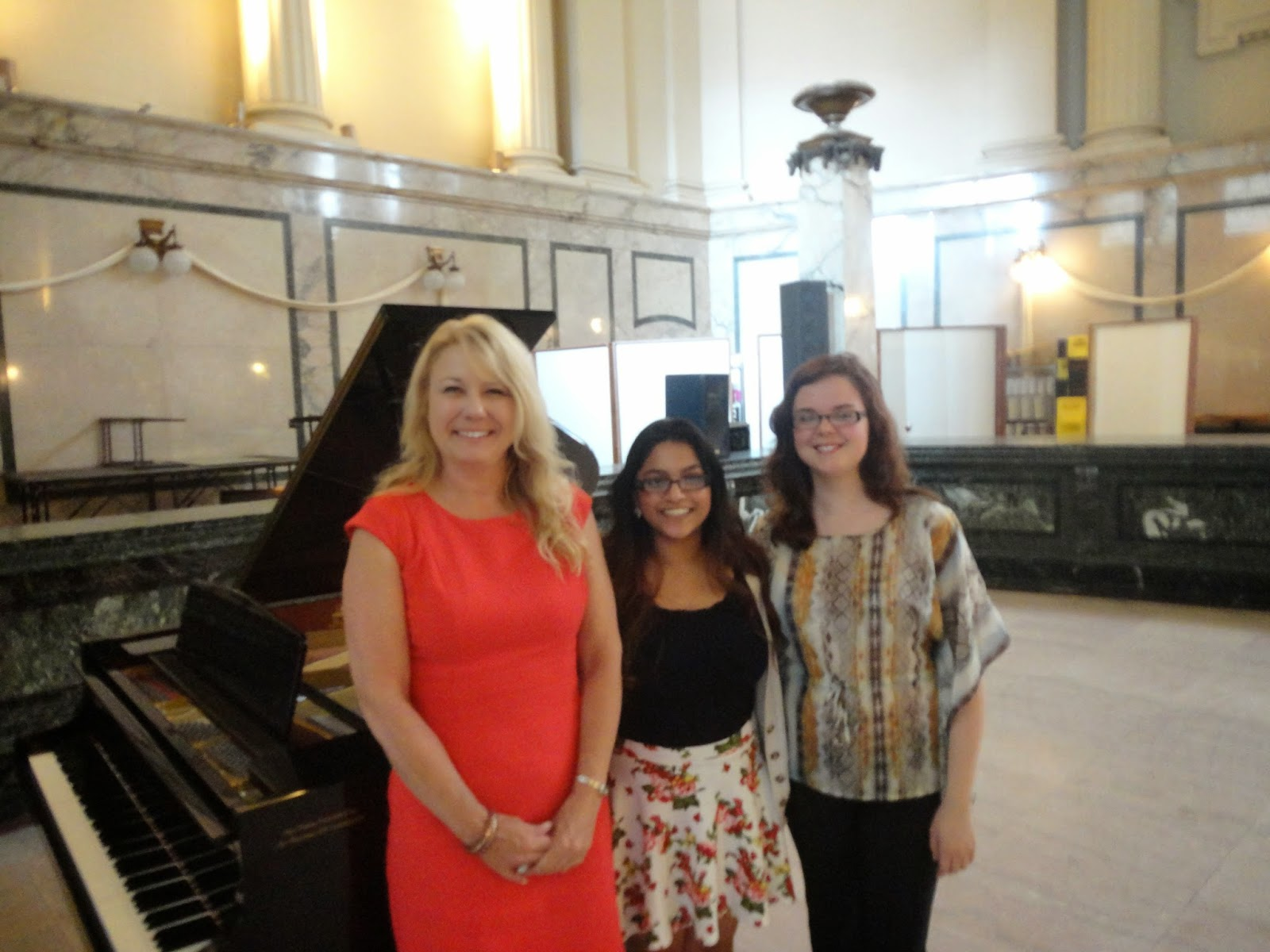 HW Executive Director Cindy Tugwell, Roshanie, and Laura at the Millennium Centre.