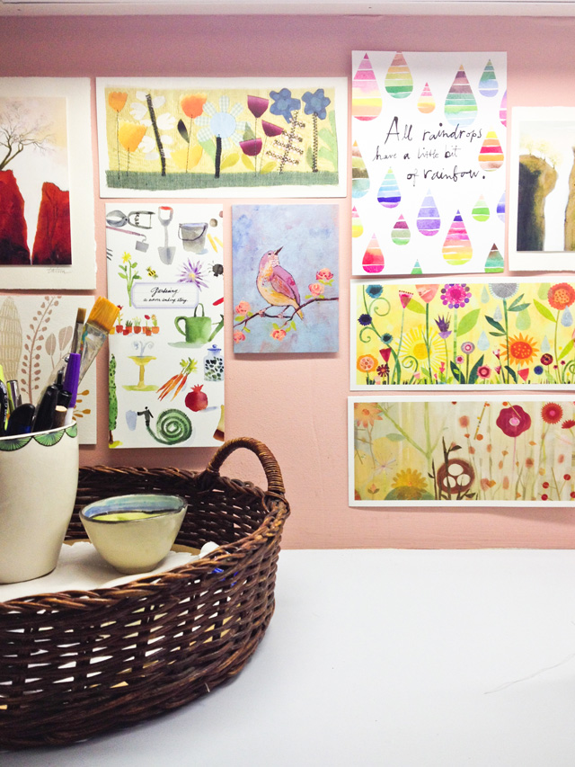 display of collection of art print cards in Mama Bleu Designs Studio