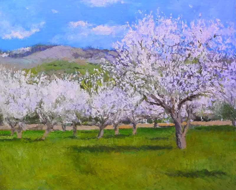 Cuadro al óleo de un paisaje de almendros en flor