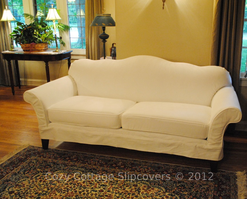 love the hump back shape of this sofa. This slipcover was done in a