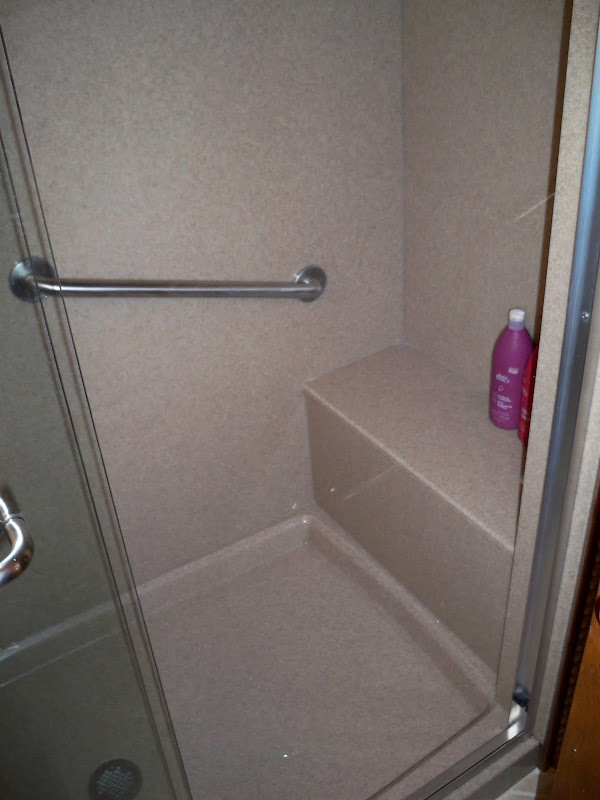 The custom built shower with seat replaced the old bathtub. title=