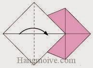 Bước 6: Gấp góc trái tờ giấy vào trong.