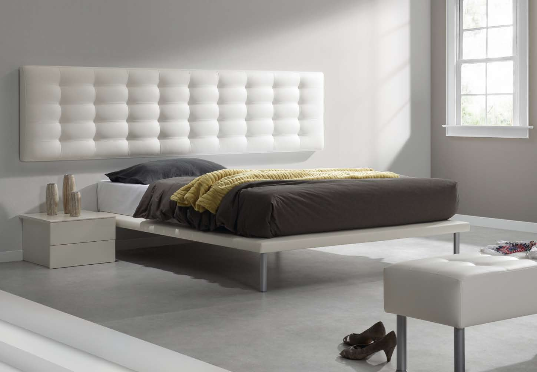 cabeceros y camas tapizadas en o tela