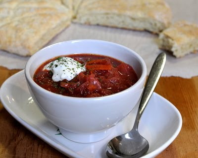 Karelian Borscht (Russian Beet Borscht Soup), extra hearty with sausage and a swirl of sour cream but also especially earthy and delicious as a vegetarian borscht.