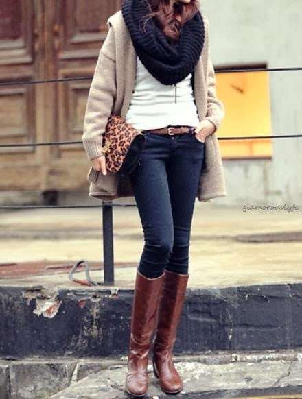 Grey overcoat, black scarf, white blouse, cheetah mark handbag and jeans with long brown boots