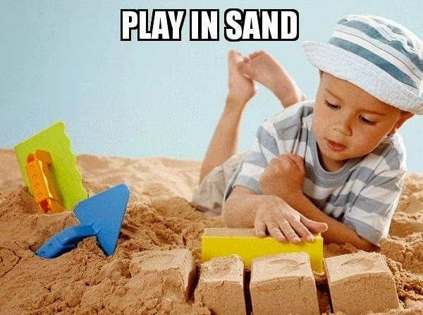 kid playing in sand