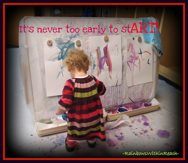 "photo of: ""It's Never too Early to Start Art"" Young Child at Easel Painting"