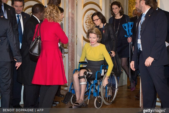 Queen Mathilde of Belgium sitting in a wheelchair, following a knee injury, arrives to attend a conference on Ebola on March 3