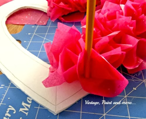 showing how to press tissue onto pattern with pencil
