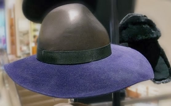 Leather and felt brimmed hat at Barneys.