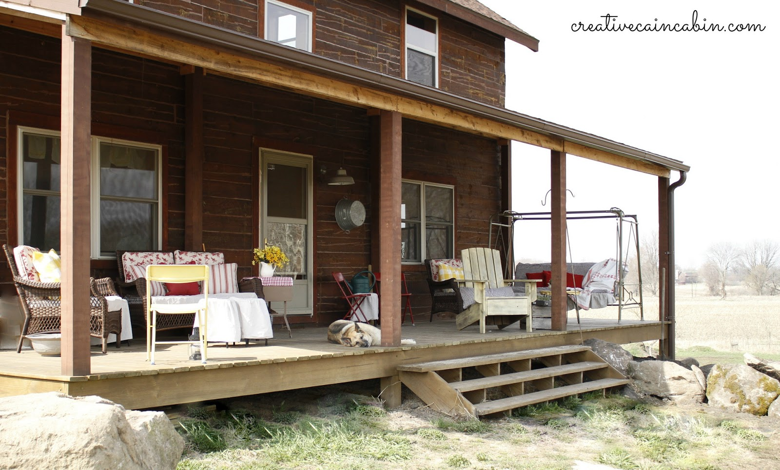 front porch of a log home in spring creative cain cabin