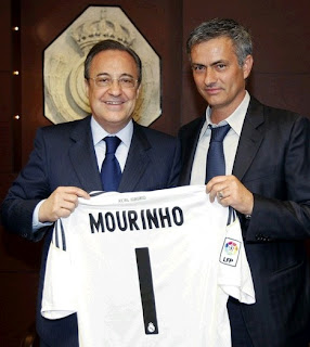 Mourinho with Florentino Perez and the Real Madrid jersey on the hands